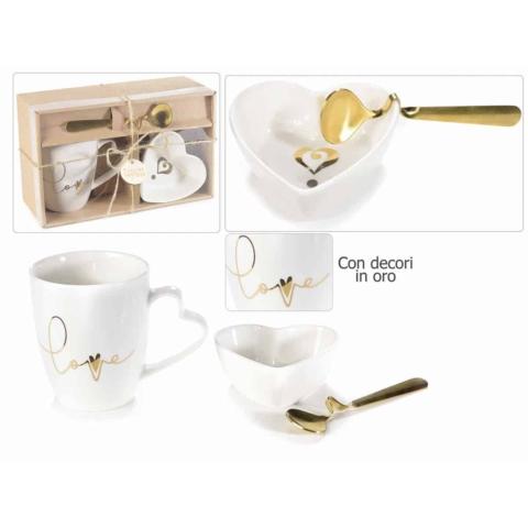 tazzina caffè con cucchiaio dorato